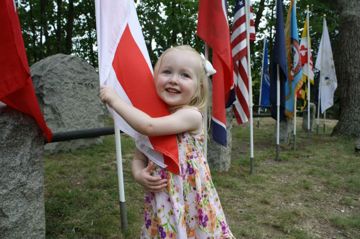 Elysia, 2, hugs a state flag during a visit to Ox Hill Battlefield Park, Fairfax County, Va. More than 1,500 soldiers were killed or wounded during this Civil War battle on Sept. 1, 1862. Photo courtesy of Seth Cooper.