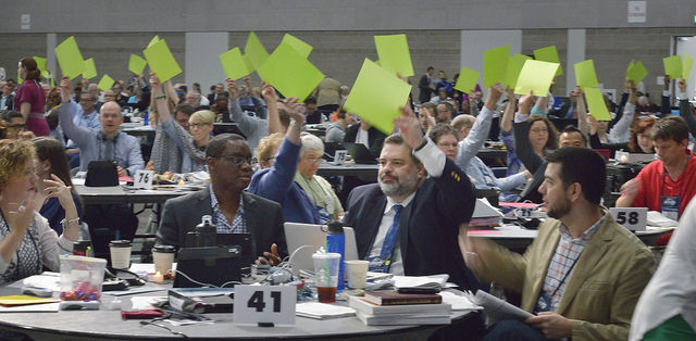 Faced with glitches in the electronic voting system, delegates use colored cards to vote on May 16 at the 2016 United Methodist General Conference in Portland, Ore.
