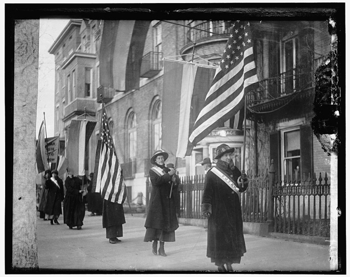 Suffragettes march with flags in Washington, D.C., in an archival image dated 1910 to 1920. Six Methodist women advocated for women's voting rights as part of their Christian calling. Photo courtesy of the Library of Congress, Prints and Photographs Division.
