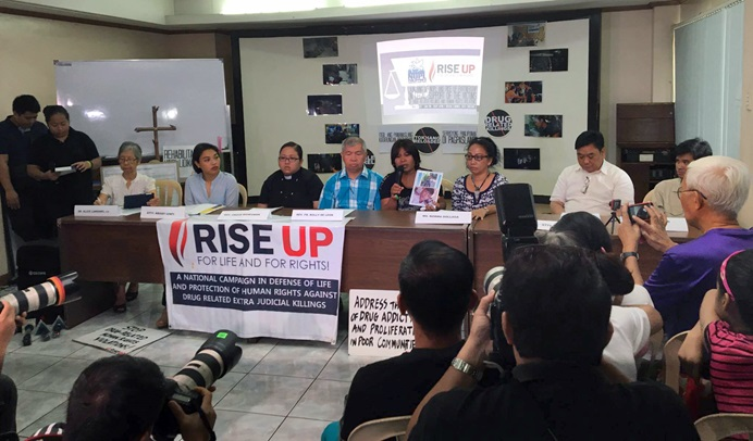 Rise Up for Life and for Rights and the National Union of People's Lawyers-National Capital Region joined forces during a press conference to condemn drug-related extrajudicial killings and violations. Emily Soriano holds a photo of her son, who was killed in 2016. To her left are Norma P. Dollaga, a United Methodist deacon, and Ephraim Cortez, an attorney who is a United Methodist. Photo courtesy of Rise Up for Rights and For Life.