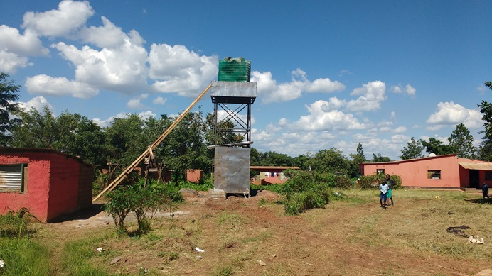 A new water tank helps combat cholera by providing clean water at the Jerusalem United Methodist Church in the community of Kandundu, Zambia. Photo by John Chikuta, UMNS.