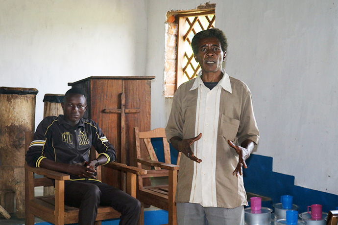 The administrative secretary of the Kasongo-Samba District, Lombe Penekitu, extends his hands in thanks to The United Methodist Church for its help with aid and shelter for those fleeing rebel violence in the Democratic Republic of Congo. Photo by Judith Osongo Yanga, UMNS.