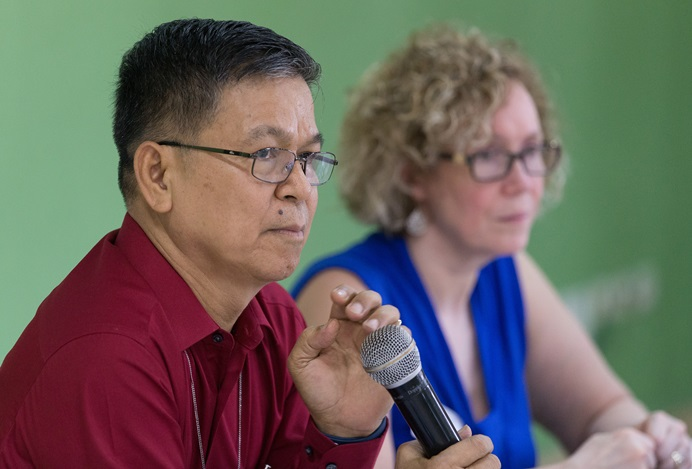 Bishop Ciriaco Q. Francisco (left) presides over a meeting of the United Methodist Committee on Central Conference Matters in Abidjan, Côte d'Ivoire. At right is the Rev. Deanna Stickley-Miner. Photo by Mike DuBose, UMNS.