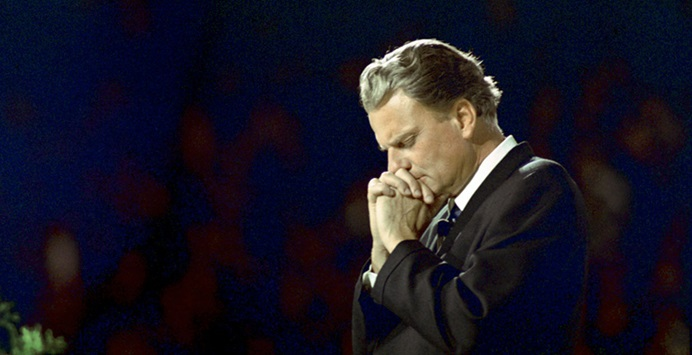 Rev. Billy Graham in prayer. Photo courtesy of the Billy Graham Evangelistic Association