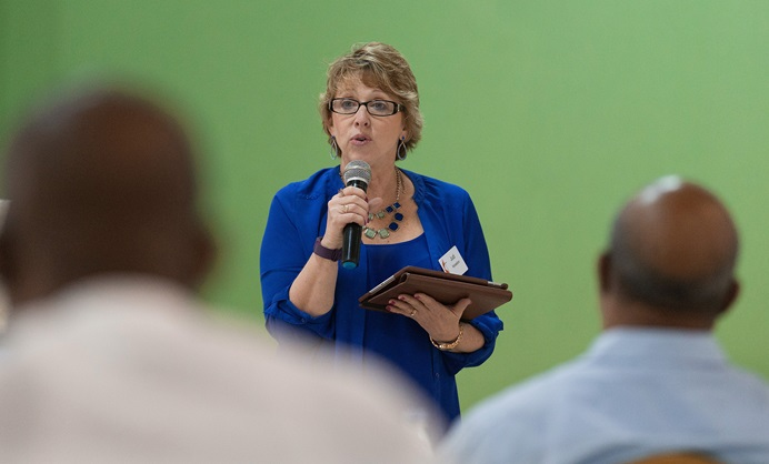 Judi Kenaston makes a presentation during a meeting of the United Methodist Standing Committee on Central Conference Matters in Abidjan, Côte d'Ivoire. Kenaston, a Connectional Table member from the West Virginia Conference, has been leading that group's discussion about what a possible new U.S. church structure might look like. Photo by Mike DuBose, UMNS.