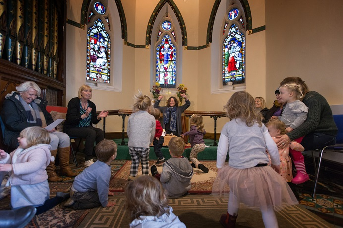 "The Rev. Katy Thomas (rear) presides over a ""Tiddly Nativity"" activity for young children at St. Mary's Methodist Church in Handforth, England. The church is one of three Thomas serves in the Greater Manchester area. Photo by Mike DuBose, UMNS."