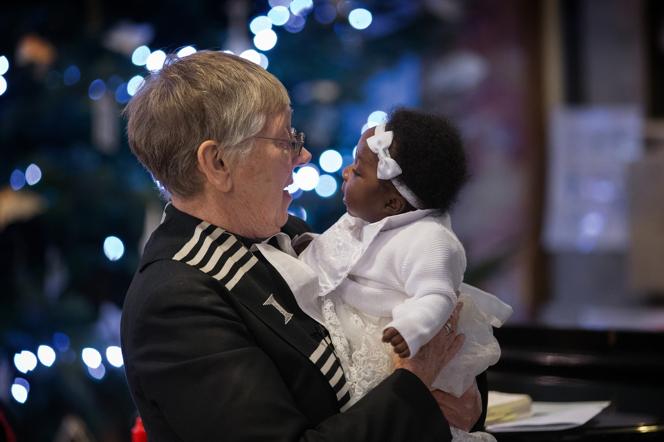 The Rev. Jennifer Potter holds Abigail Bedu Addo during her baptism at Wesley's Chapel in London. The congregation, with roots in the 18th century, draws Methodists from around the world. Photo by Mike DuBose, UMNS.