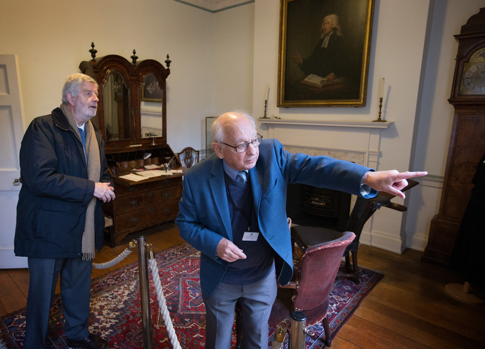 Tour guide Allen Steel (right) points out the gravesite of Susanna Wesley, mother of John and Charles Wesley, through a window in the study at Wesley's Chapel. At left is the Rev. John Lampard, a retired minister and member of the congregation at the historic church. Photo by Mike DuBose, UMNS.