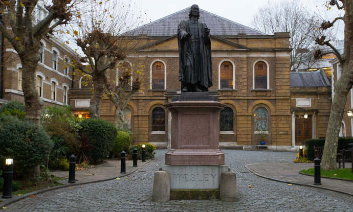 At statue of John Wesley sculpted by John Adams-Acton stands in the forecourt of Wesley's Chapel. Photo by Mike DuBose, UMNS.