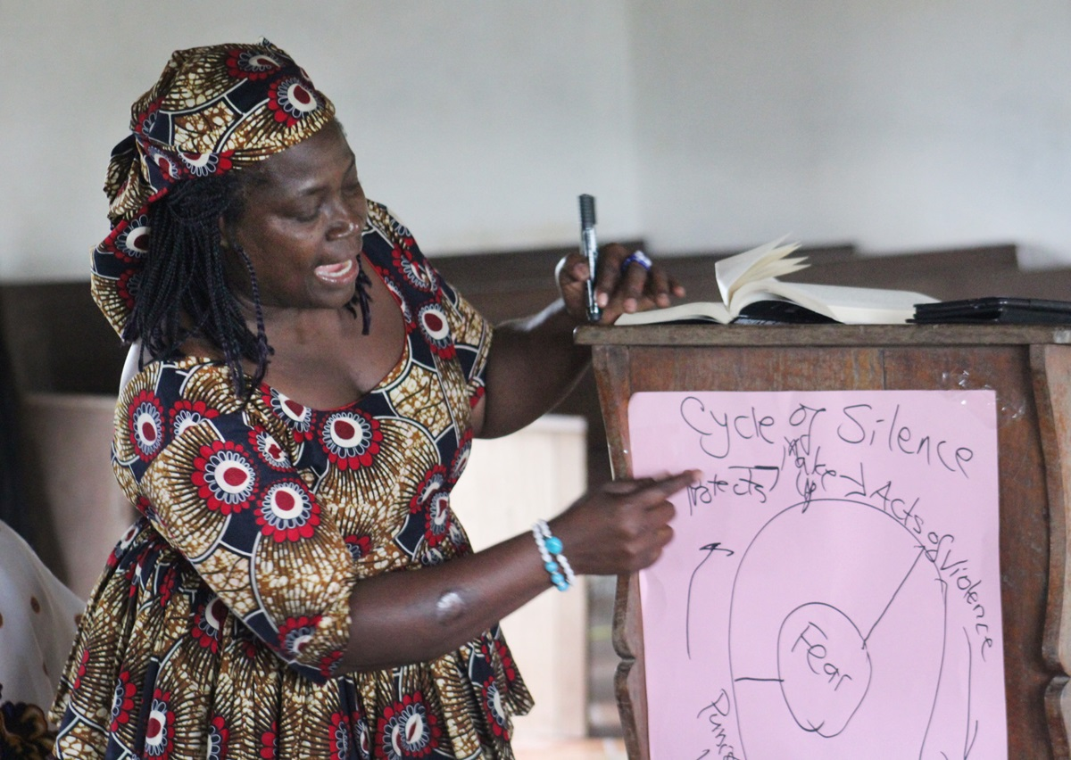 Muriel V. Nelson, president of United Methodist Women of Liberia, leads a discussion on breaking the cycle of violence against women during a four-day Ubuntu Missionary Journey in Diecke, Guinea. Photo by E Julu Swen, UMNS.