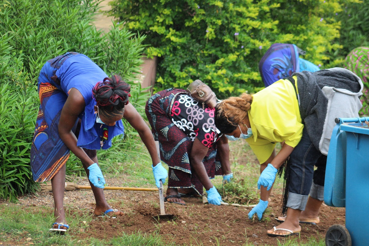 United Methodist Women from Liberia clean the area around The United Methodist Church Hospital in Diecke, Guinea, during a four-day Ubuntu Missionary Journey. Photo by E Julu Swen, UMNS.