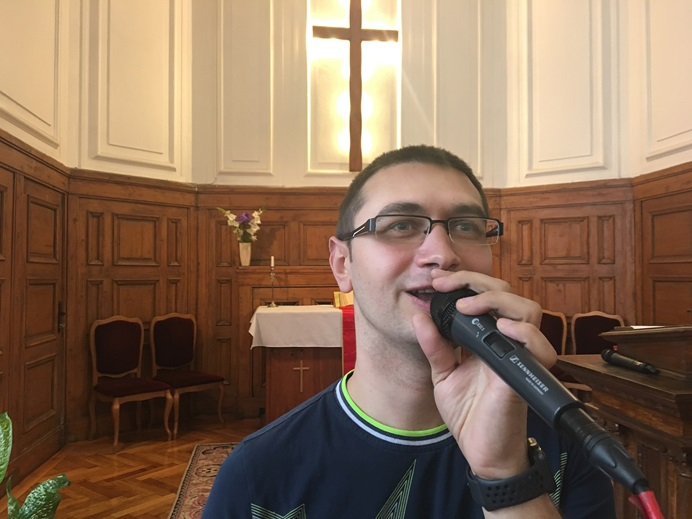 Presian Vlaiakov sings at the Sofia (Bulgaria) United Methodist Church. Vlaiakov, the son of a single mother, said his commitment to the church grew out of the love and help the church showed him as a child. Photo by the Rev. Mihail Stefanov.