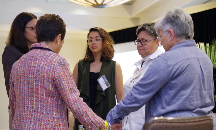 Members of MARCHA, meeting in Charlotte, N.C., pray together following a panel discussion on proposals to end The United Methodist Church's division over homosexuality. From left are: the Rev. Ana Awilda Nolla, Bishop Cynthia Fierro Harvey, Rosie Rios and the Revs. Rosario Quiñones and Rosanna Panizo. Photo by Gustavo Vasquez, UMNS.