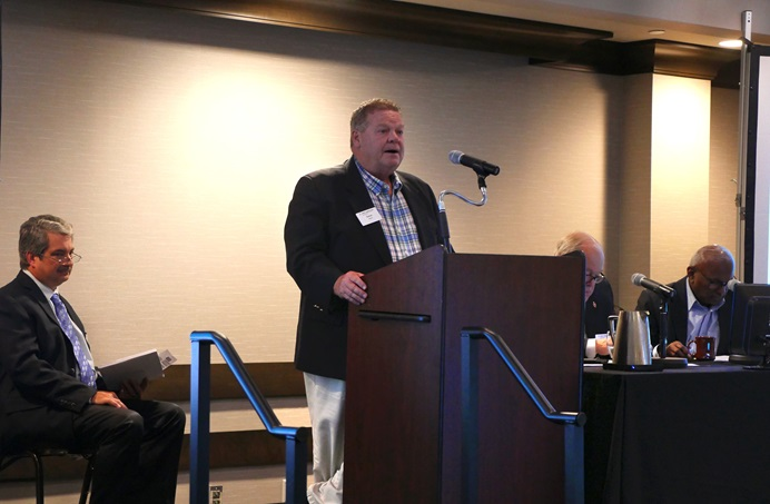 The Rev. Steve Wood presents information on the general church budget to the fellow board members of the General Council on Finance and Administration. Rick King, the agency's chief financial officer, is at left. The board is recommending substantially cutting the 2021-24 general-church budget in hopes of keeping more funds in U.S. local churches. Photo by Heather Hahn, UMNS.
