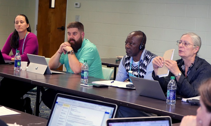 The Rules Committee of the Commission on General Conference discusses plans for one legislative committee at the 2019 special session. From left are Stephanie Henry, chair of the Rules Committee; commission members Audun Westad and Stanislas Kassongo, and translator Isabelle Berger. The commission met Oct. Oct. 3-5 at Epworth by the Sea in St. Simons, Ga. Photo by Heather Hahn, UMNS.