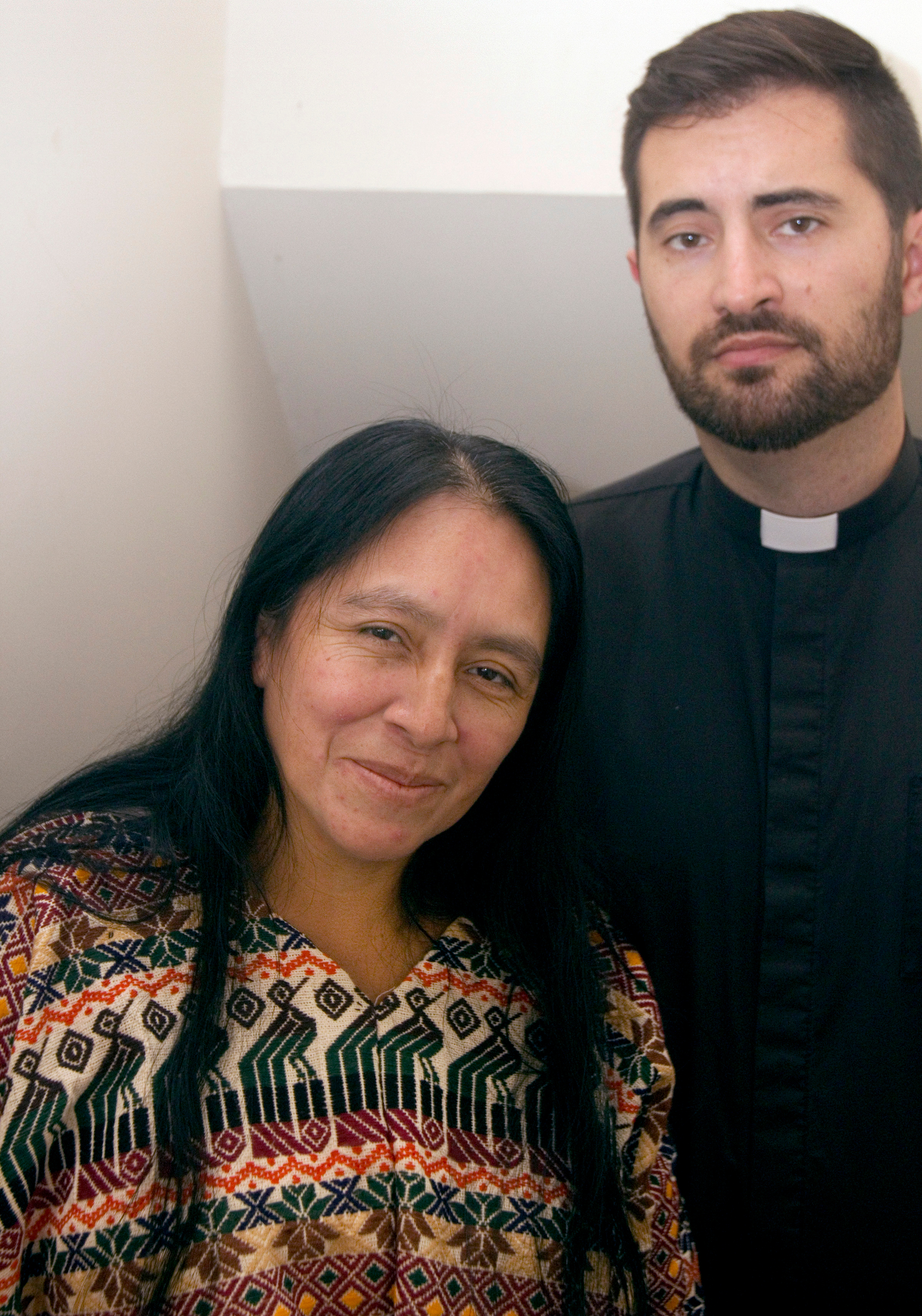 Maria Chavalan Sut stands with the Rev. Isaac Collins, pastor of Wesley Memorial United Methodist Church, at a press conference held Oct. 8. Chavalan Sut is living in the church to avoid deportation. Photo by Richard Lord, UMNS.