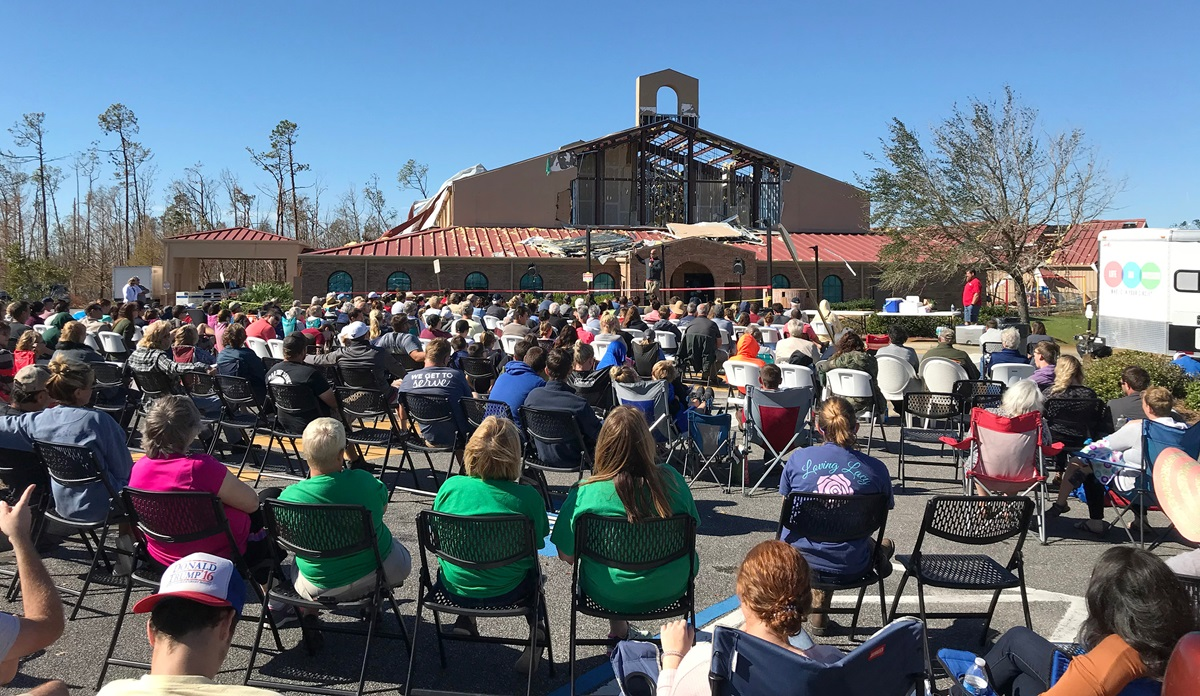 The congregation of Lynn Haven United Methodist Church in Panama City, Fla., worships in the parking lot of their sanctuary, which was destroyed by Hurricane Michael. About 250 worshipers attended. Photo courtesy of Lynn Haven United Methodist Church.