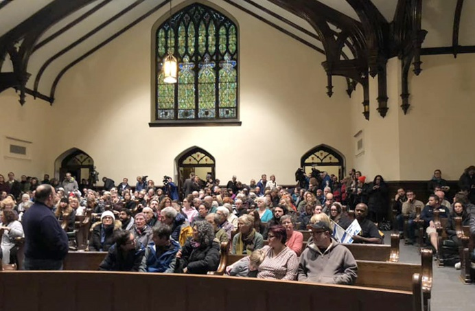 People gather for an interfaith prayer vigil at Sixth Presbyterian Church in Pittsburgh following a mass shooting at the city's Tree of Life synagogue. Photo by the Rev. Dawn Hand.