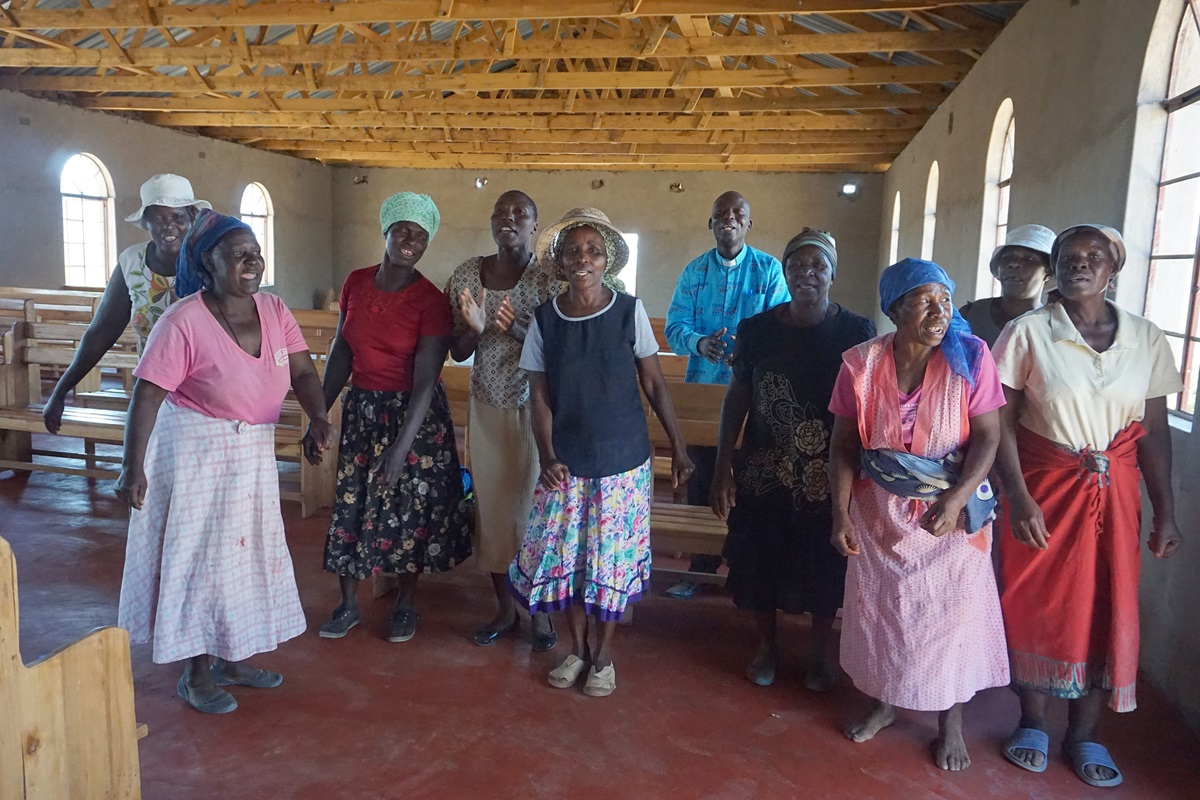 Church members in the Shapure community of Nyanga, Zimbabwe, celebrate the new sanctuary donated to their community by United Methodists from Flekkefjord, Norway. Photo by Kudzai Chingwe, UMNS.