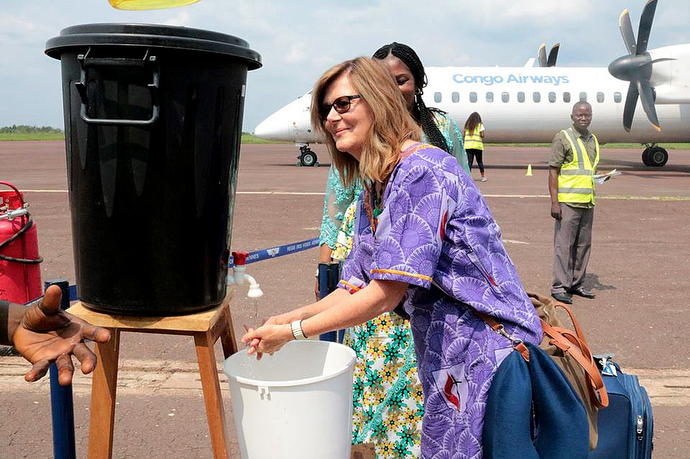 The Rev. Neelley Hicks washes her hands at Kindu National Airport in Congo. The washing station and temperature monitors were installed at the airport and other entrances to the city to help prevent the spread of Ebola. Hicks is executive director of Harper Hill Global, which is helping raise awareness about Ebola. Photo by Chadrack Tambwe Londe, UMNS.