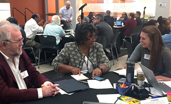Connectional Table members talk about ways to strengthen relationships across all levels of the denomination. Pictured from left are the Rev. Ole Birch of Denmark, Benedita Penicela-Nhambiu of Mozambique and Michelle Hettman of the Virginia Conference. Photo by Heather Hahn, UMNS.