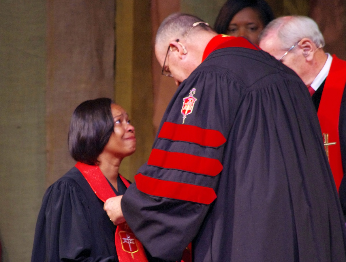 Bishop Sharma Lewis shares a moment with Bishop Lindsey Davis, her former bishop in North Georgia Conference, during her consecration on July 15, 2016, at Lake Junaluska Conference and Retreat Center at Lake Junaluska, N. C. File photo by Burt Williams, Western North Carolina Conference.