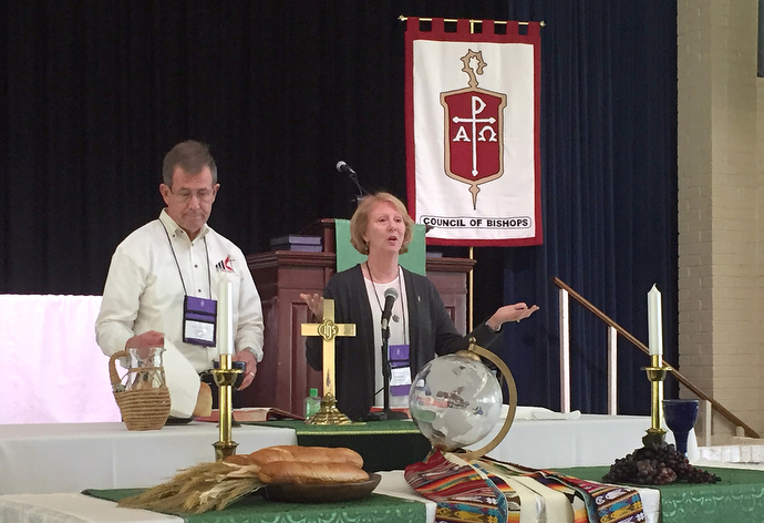 Bishops Scott Jones of the Texas Conference and Sue Haupert-Johnson of the North Georgia Conference celebrate Holy Communion during the closing worship of the Council of Bishops meeting. Bishops discussed their role at the special General Conference during their meeting at Epworth by the Sea on St. Simons Island, Ga. Photo by Heather Hahn, UMNS.