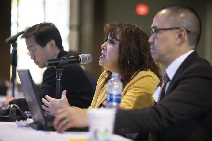 Bishop Minerva Carcaño asks a question during the board meeting of the General Council on Finance and Administration held at Providence United Methodist Church in Mount Juliet, Tenn. on Nov. 16, 2018. Pictured (from left) are Kenneth Ow, Carcaño, and the Rev. Anthony Tang. Photo by Kathleen Barry, UMNS.