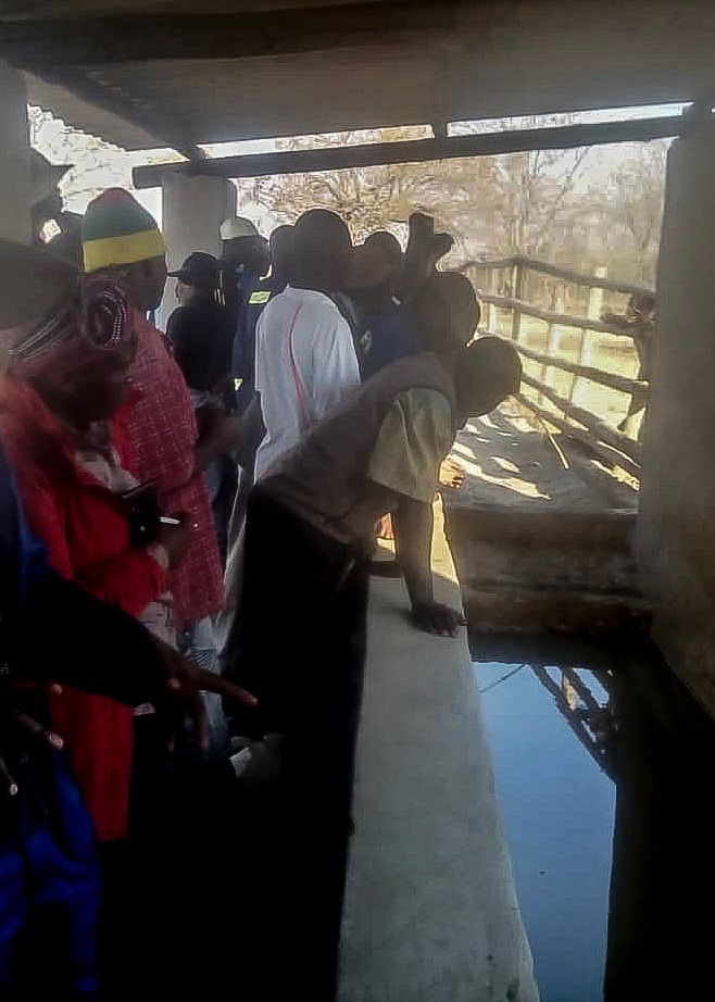 Visitors view the interior of the cattle dip tank in in Nyamacheni, a rural community about 400 kilometers west of Harare, Zimbabwe. Photo by Everisto Gumbo.