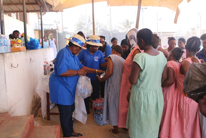 Members of The United Methodist Church's Prison Ministry in Sierra Leone hand out food and drinks to inmates at the female correctional center in Freetown, Sierra Leone, as part of its Christmas outreach program. Photo courtesy of Saidu Samura, Sierra Leone Correctional Service.