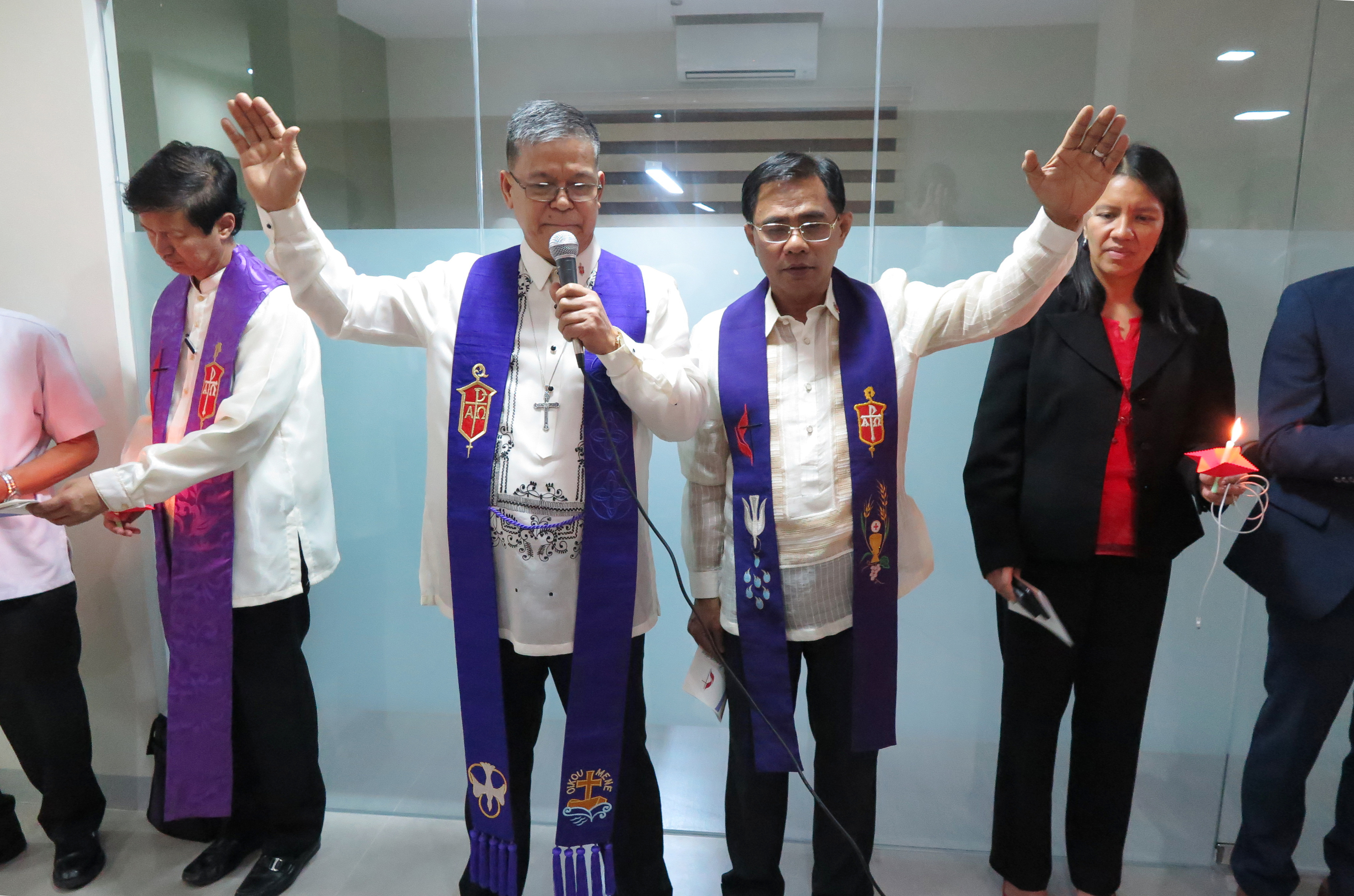 Bishops Ciriaco Q. Francisco and Rodolfo A. Juan raise their hands in blessing during the dedication ceremony. Bishop Pedro M.  Torio Jr. and the Rev. Amy Valdez-Barker are in the background. Photo by Tim Tanton, UMNS.
