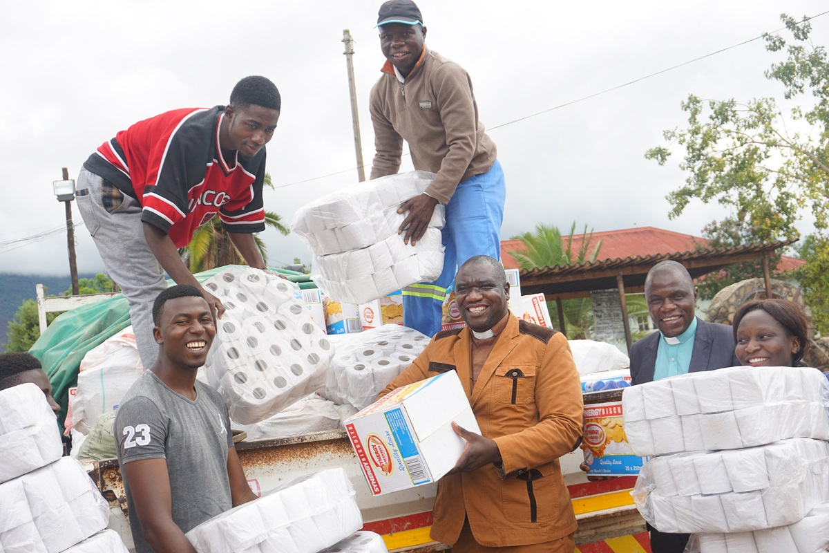 Clockwise from top center, Blessing Ngorima, Kumbirai Mambara, the Rev. Willard Karamba, the Rev. Togara Bobo, Shadreck Tanyaradzwa Majuru and Simbarashe Chandanakira deliver donations to Mutare Provisional Remand Prison in Zimbabwe. Photo by Kudzai Chingwe, UMNS.
