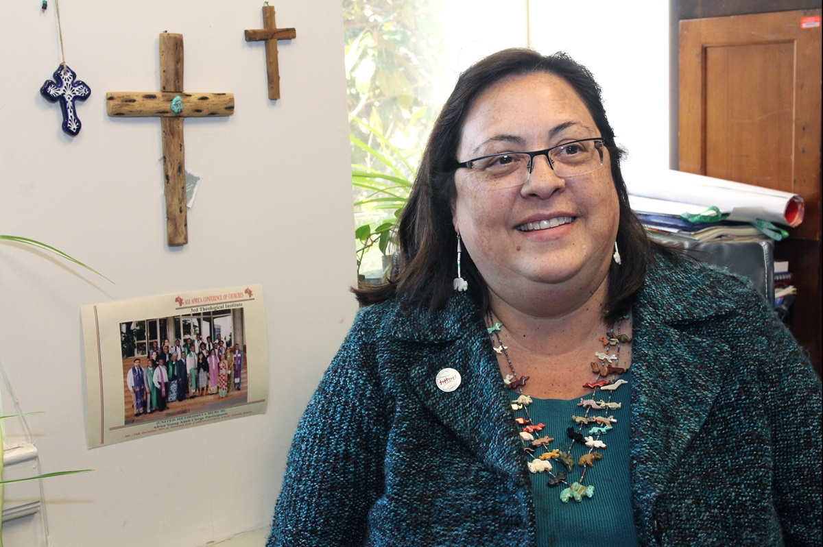 The Rev. Cynthia Abrams, a United Methodist clergywoman and social justice advocate, is pictured in her office at the Board of Church and Society in 2012. Abrams died Jan. 11 at the age of 58. File photo by Kathleen Barry, UMNS.