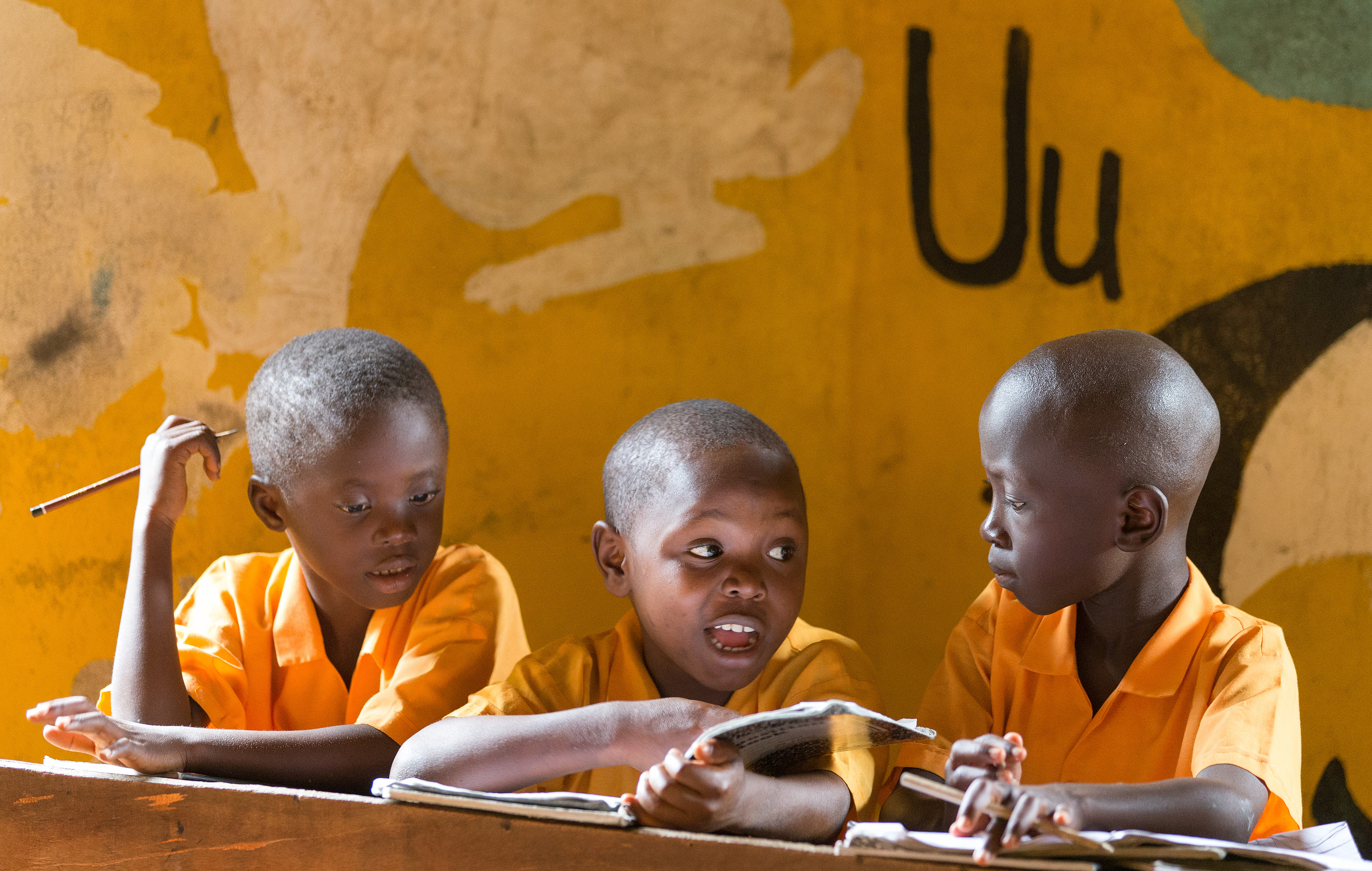Students work together on spelling words at the Bishop Judith Craig Children's Village in Duahzon, Liberia, in 2017. The facility was established in 2000 to provide care for children left orphaned by Liberia's civil war. File photo by Mike DuBose, UMNS.