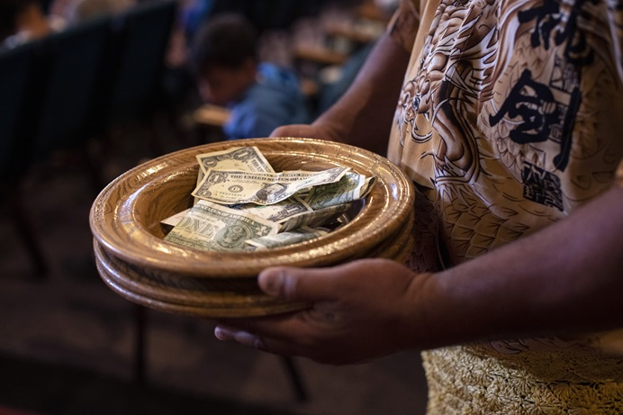 A Sunday collection is taken up at the Tongan United Methodist Church in West Valley City, Utah. Twenty-six U.S. conferences in 2018 paid full apportionments, including the Tongan congregation's home conference. Photo by Kathleen Barry, UMNS.