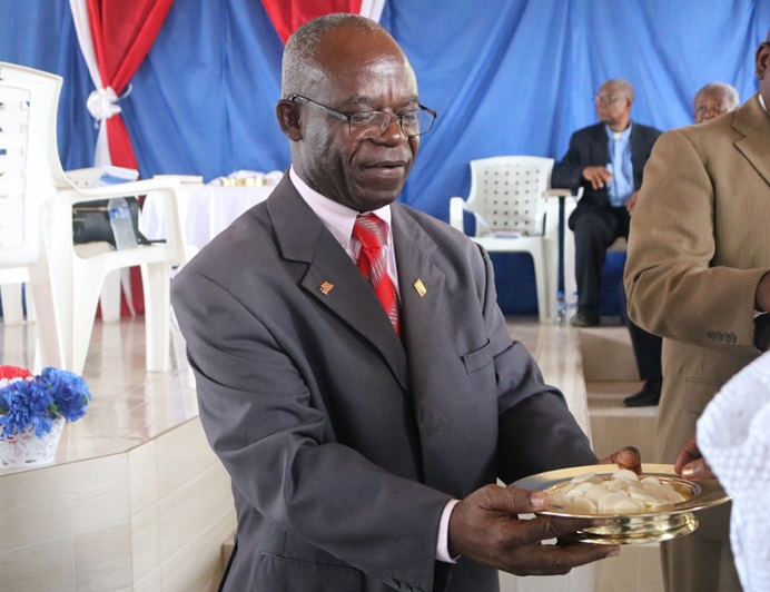 The Rev. Jerry P. Kulah serves communion during the opening session of the 72nd Annual Conference of  the United Methodist Women in Marshall, Liberia. Photo by E Julu Swen, UMNS.