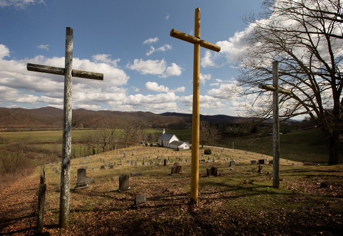 Three crosses stand above the cemetery at Israel United Methodist Church near Montrose, W.Va., in 2015. Leaders of rural churches have expressed concerns about the impact that decisions made at the special General Conferences could have on rural and small congregations. File photo by Mike DuBose, UMNS.
