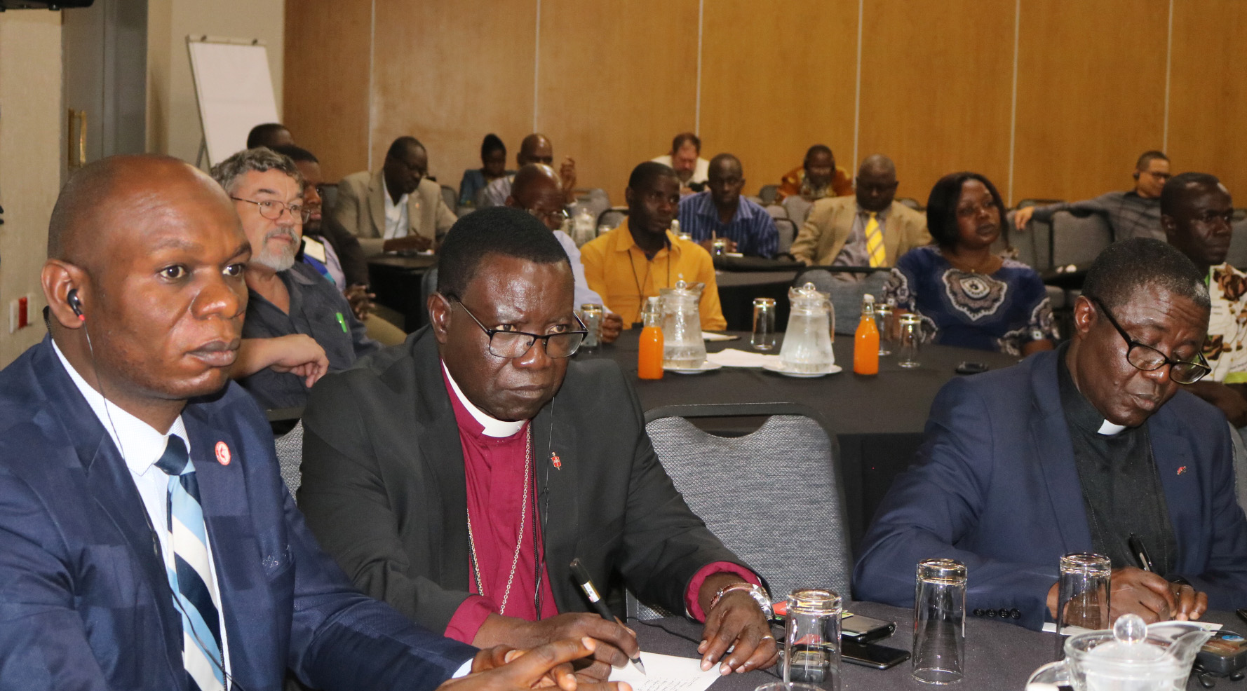 Bishop Kasap Owan from the South Congo Episcopal area (center) and delegates listen during the United Methodist Board of Global Ministries/United Methodist Committee on Relief agricultural summit in Johannesburg. Photo by Eveline Chikwanah.