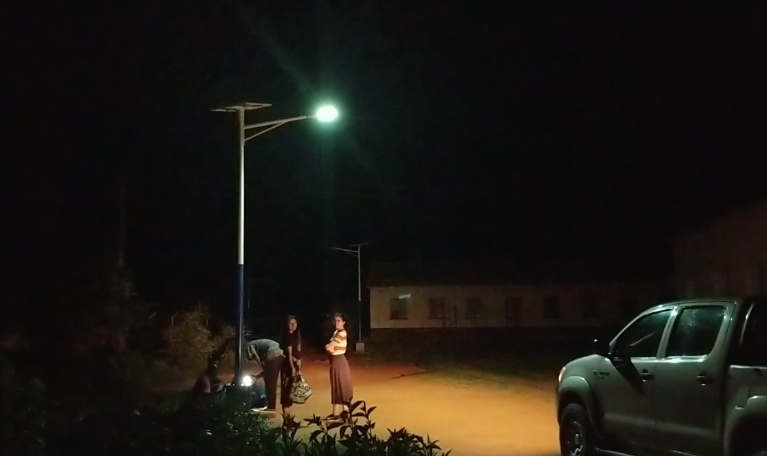 Students with Engineers Without Borders USA observe solar lights during a night tour at Nyadire Mission in Zimbabwe. Photo courtesy of Chenayi Kumuterera.