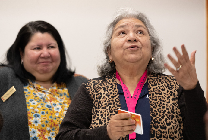Kiko Villarreal (right) tells members of the United Methodist Immigration Task Force, meeting in McAllen, Texas, about the ordeal she endured when her husband, who had lived in the U.S. for almost 50 years, was arrested after an old DUI conviction came to light during a brief trip to Mexico. Despite having paid the fine and fulfilled the terms of the criminal penalty, he was detained for three months. With her is her pastor, the Rev. Maribel Vazquez. Photo by Mike DuBose, UMNS.