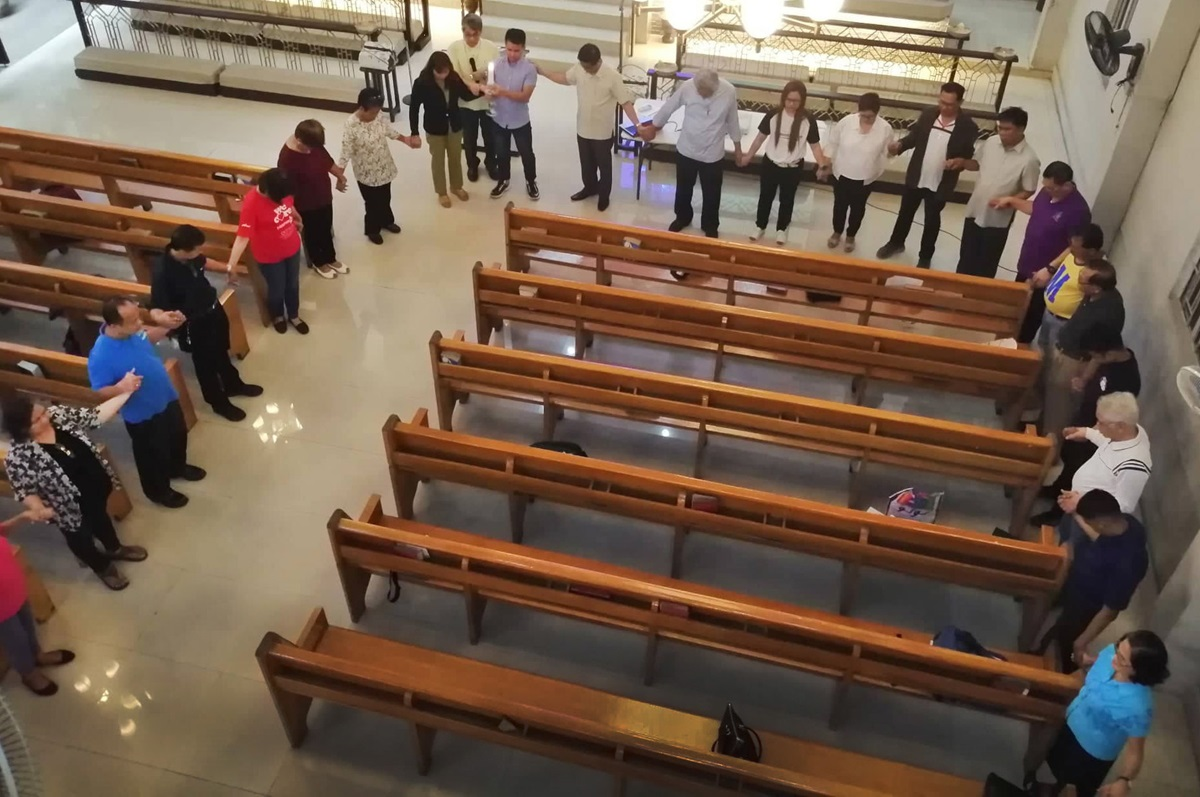 Filipino United Methodists hold hands in prayer at St. John United Methodist Church in Cubao, Philippines. The gathering was part of the denomination-wide Praying Our Way Forward initiative. Photo by Gladys Mangiduyos, UMNS.