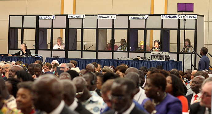 Language interpreters are vital to the work of General Conference. Here, working from booths behind seated delegates, they rendered in various languages a worship service at the 2016 General Conference in Portland, Oregon. Photo by Kathleen Barry, UMNS