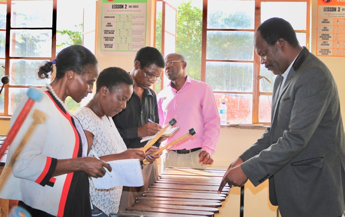 Walter Mujuru (right), Zimbabwe West Conference music director, teaches marimba basics to participants at the episcopal area's annual arts workshop in Mutoko, Zimbabwe. Photo by Eveline Chikwanah, UMNS.