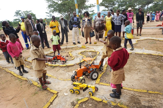 Children maneuver trucks on one of the new play areas at Hanwa Mission School in Macheke, Zimbabwe. The playground and a state-of-the-art early childhood development center were built through a partnership between the Zimbabwe Episcopal Area and Volunteers in Mission from the Baltimore-Washington Conference. Photo by Kudzai Chingwe, UMNS.