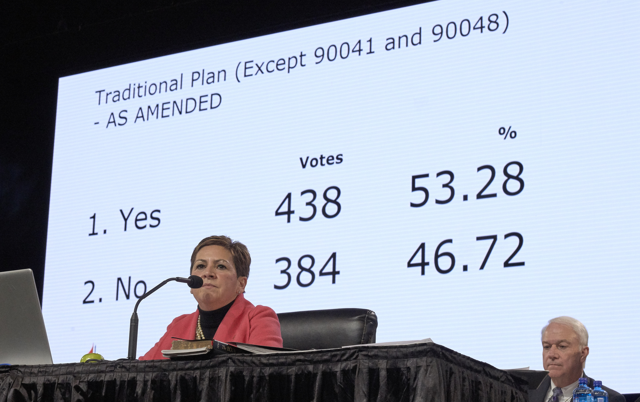 Bishop Cynthia Fierro Harvey observes the results from a Feb. 26 vote for the Traditional Plan, which affirms the church's current bans on ordaining LGBTQ clergy and officiating at or hosting same-sex marriage. The vote came on the last day of the 2019 General Conference in St. Louis. Photo by Paul Jeffrey, UMNS.