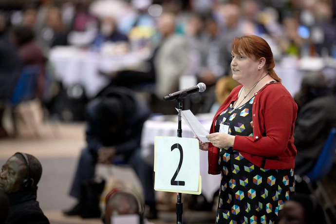 """Aislinn Deviney, a delegate from the Rio Texas Conference, speaks during the debate on a vote to strengthen denominational policies about homosexuality. Deviney, who described herself as a young evangelical, said many young people """"fiercely believe marriage is between one man and one woman."""" Photo by Paul Jeffrey, UMNS."""