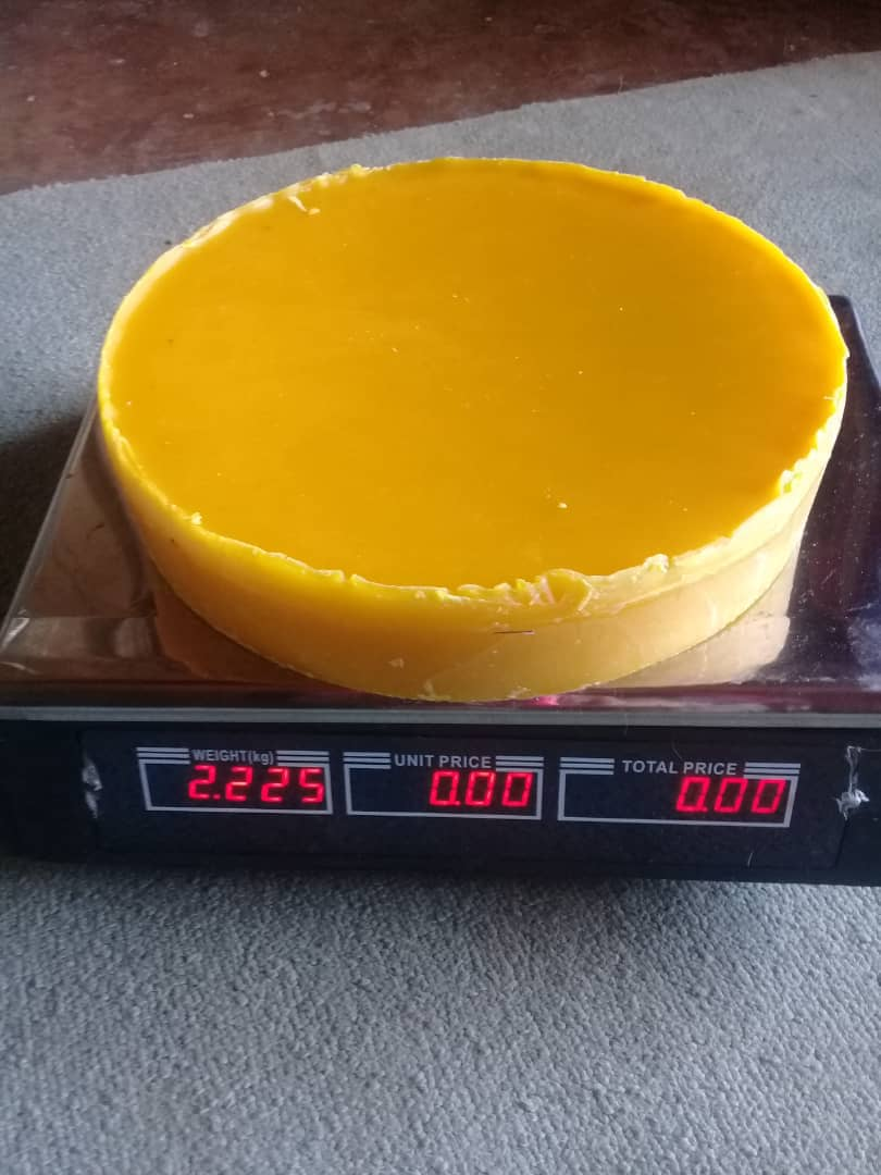 Beeswax is weighed before being sold at in Mutasa-Nyanga, Zimbabwe. Women in the Odzani Swarm Charm process honey, candles and shoe polish to sale at local markets. Photo by Kudzai Chingwe, UMNS.