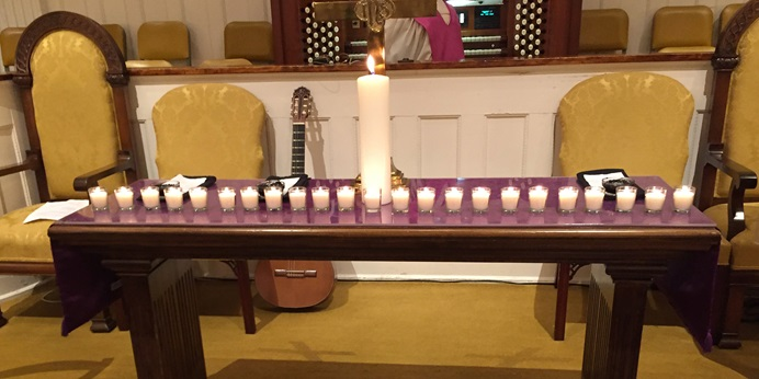 The candles on the altar at First United Methodist Church in Opelika, Ala. represent the 23 people killed in a March 3 tornado that hit Lee County, Ala. The remembrance service was held on Ash Wednesday. Photo courtesy First United Methodist Church, Opelika.