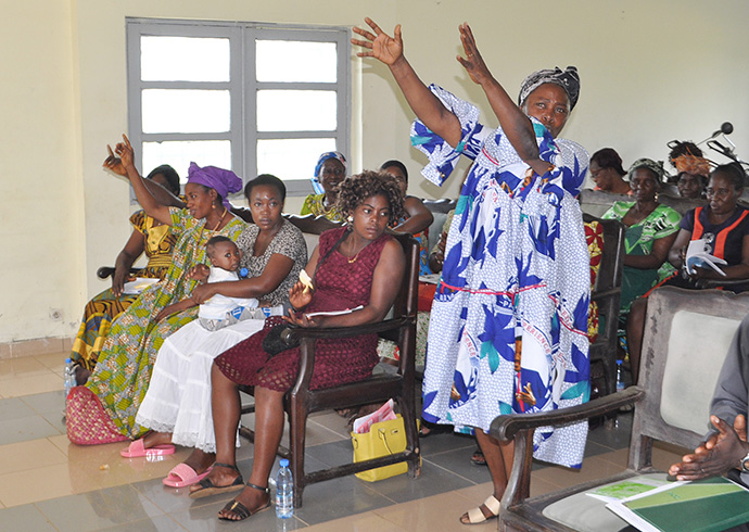Women representing diverse experiences and roles attend a workshop to raise awareness about violence and discrimination in Cameroon. Photo by Collette Ndobe.