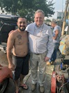 Victor Pastel (left) and Scott Gilpin after Gilpin sought shelter in Pastel's home during March 10-11 flooding and landslides in Brazil. Photo courtesy of Scott Gilpan.